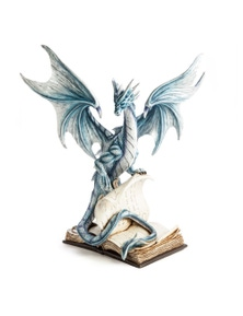 Large Blue Dragon Standing On An Open Ancient Book